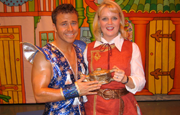 Craig holding magic lantern in pantomime
